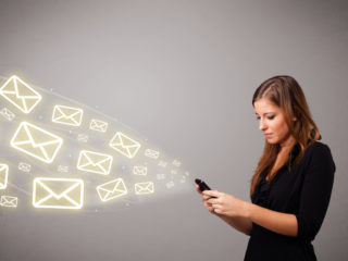 woman sending emails from phone