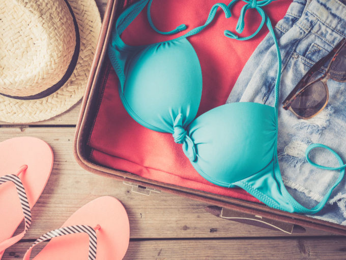 open suitcase with vacation essentials