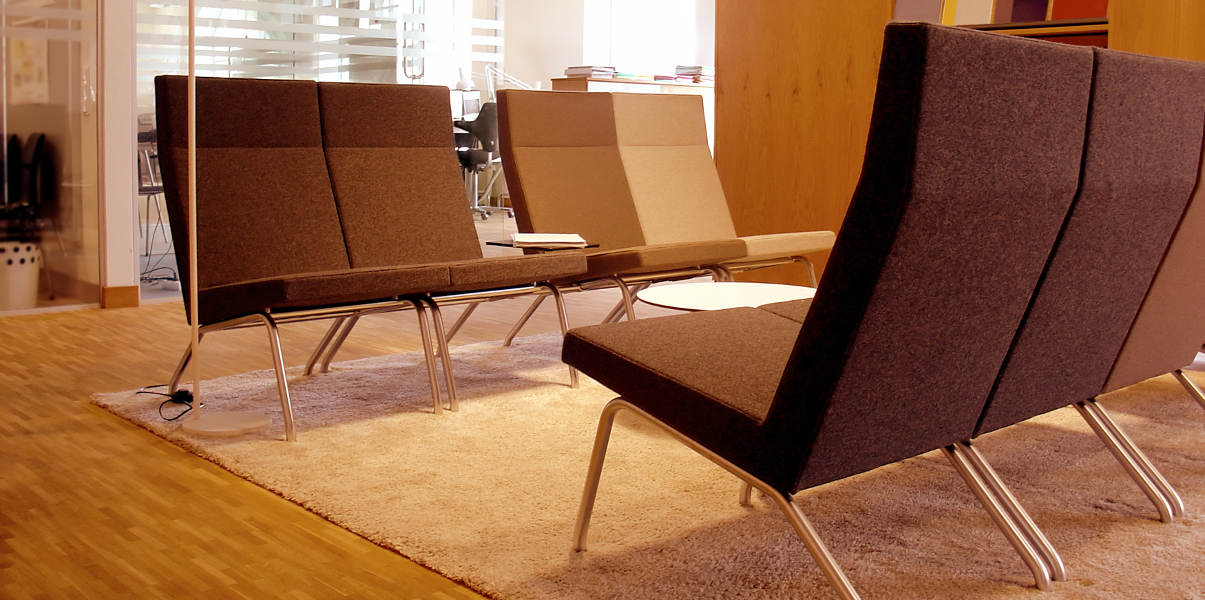 Stylish guest chairs in modern waiting room