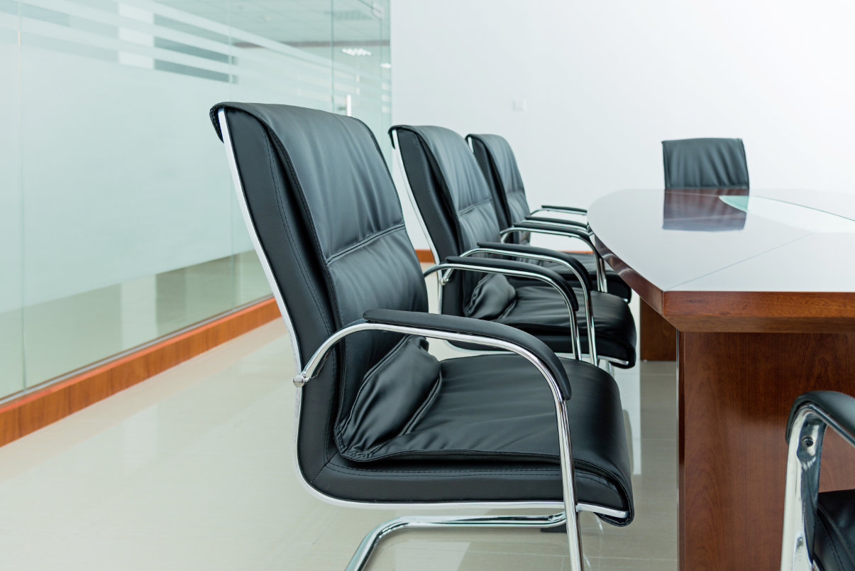 Leather office chairs in conference room.